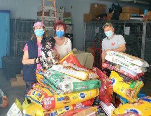 Brad, Eileen and OBOL Ambassador Molly donating to the Santa Paula Pet Food Pantry with volunteer Lee